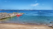 The landing stage at Caldey Island, Tenby in the distance